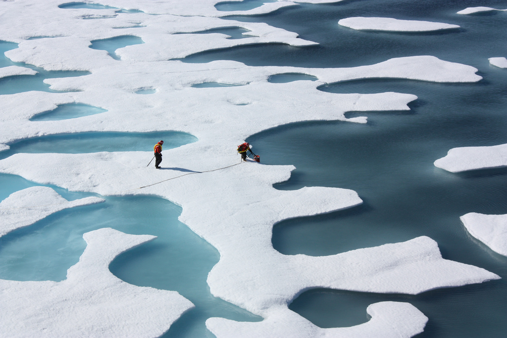 Scientists monitoring melting ice